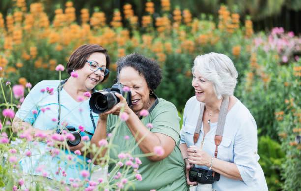 Three senior women taking photos in garden picture id1203477451?b=1&k=6&m=1203477451&s=612x612&w=0&h=fv3fjujqixodizmvwoiiemlkavogp1lbpg8mnse3c7i=