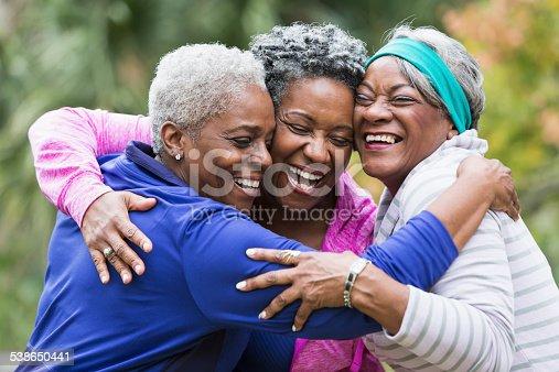istock Three seniors hugging 538650441