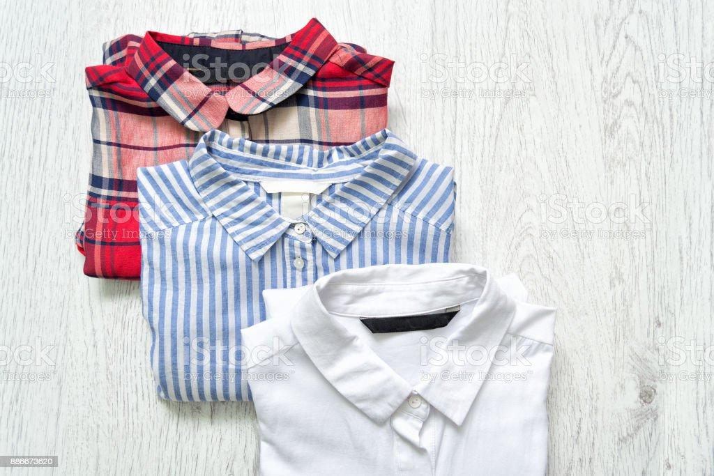 Three shirts white, checkered, striped. Collage. Fashionable concept. stock photo