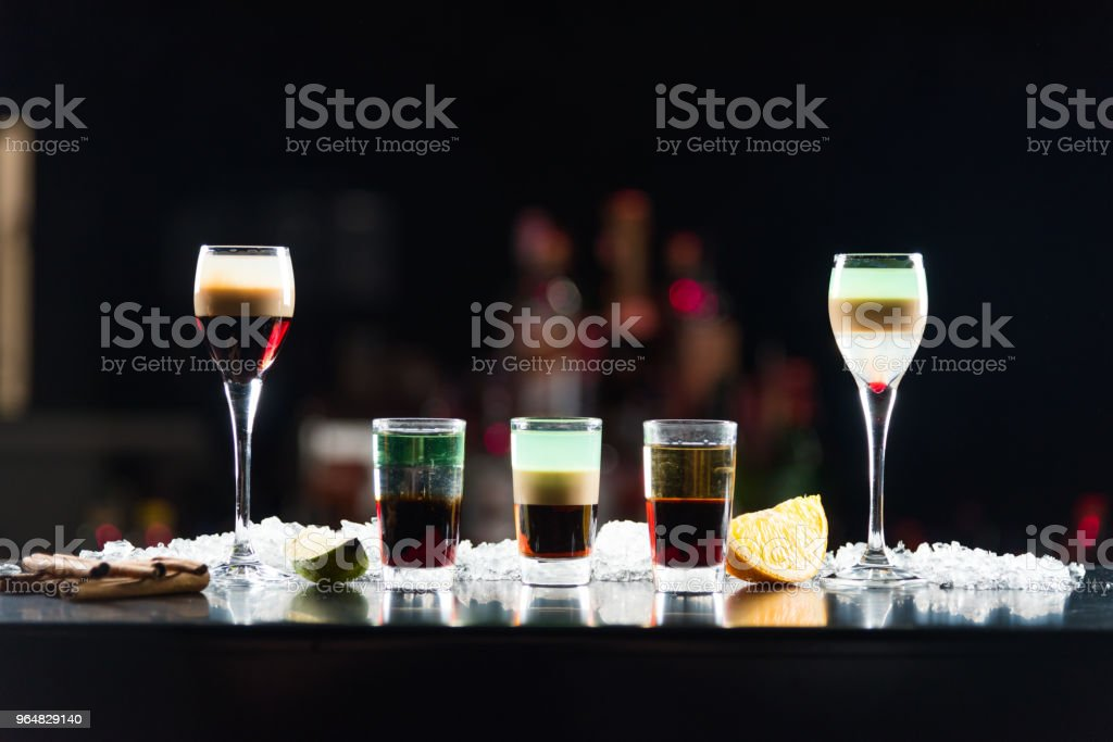 Three shots in glasses b-52 and two shots in glasses on the bar table. royalty-free stock photo