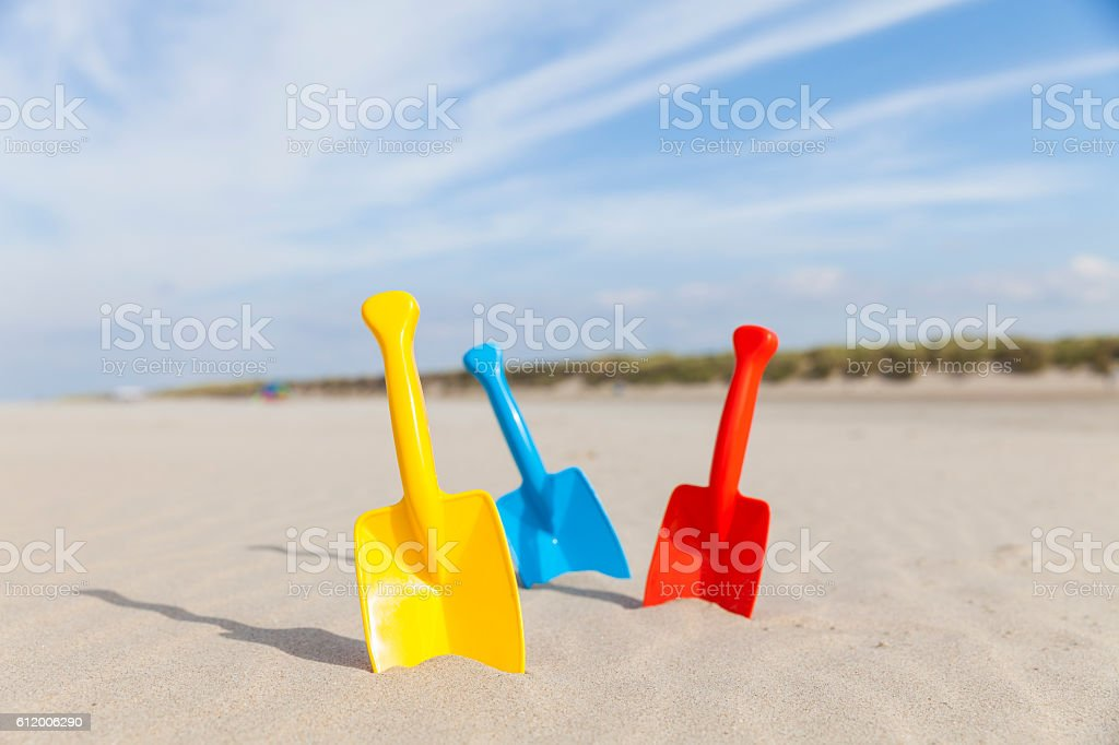 Three shovels at Renesse stock photo