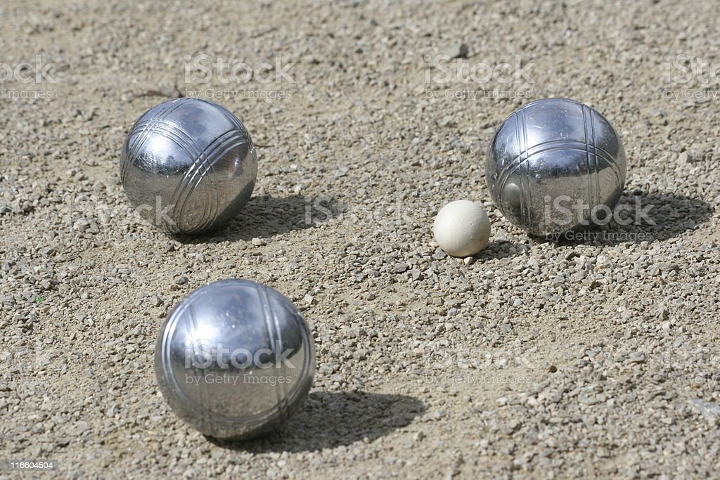 Three silver petanque on the ground stock photo