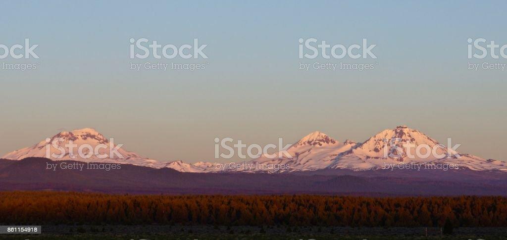 Three Sisters Alpenglow stock photo