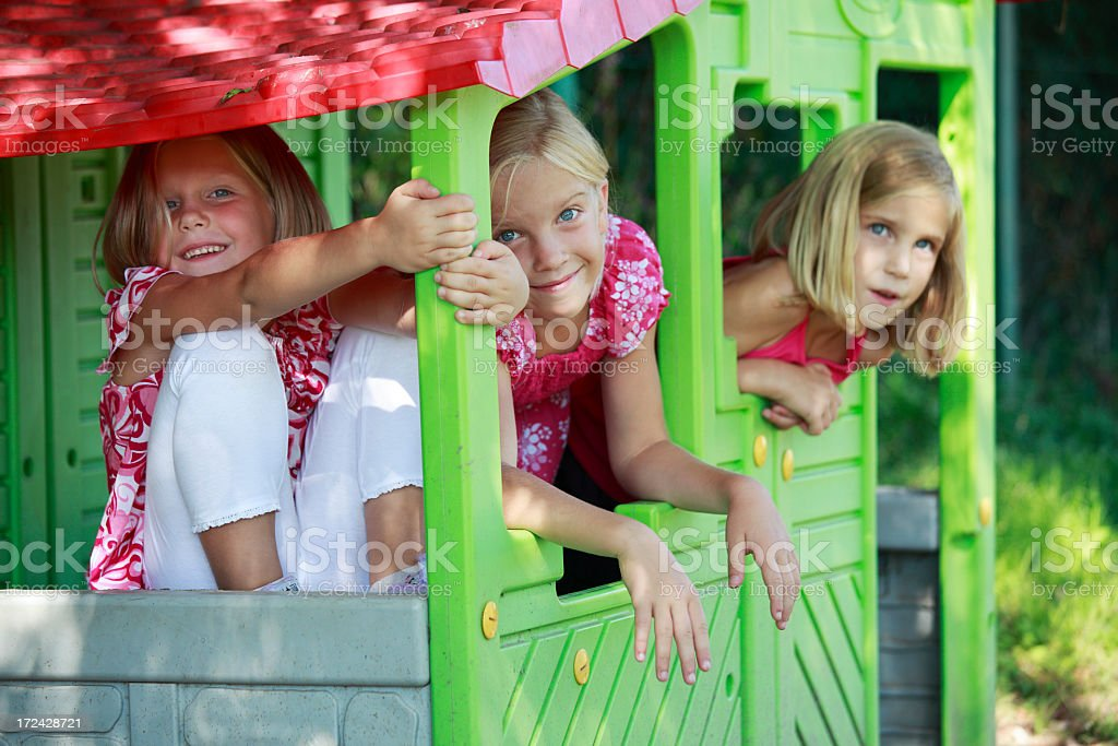 Three sisters on a playground royalty-free stock photo
