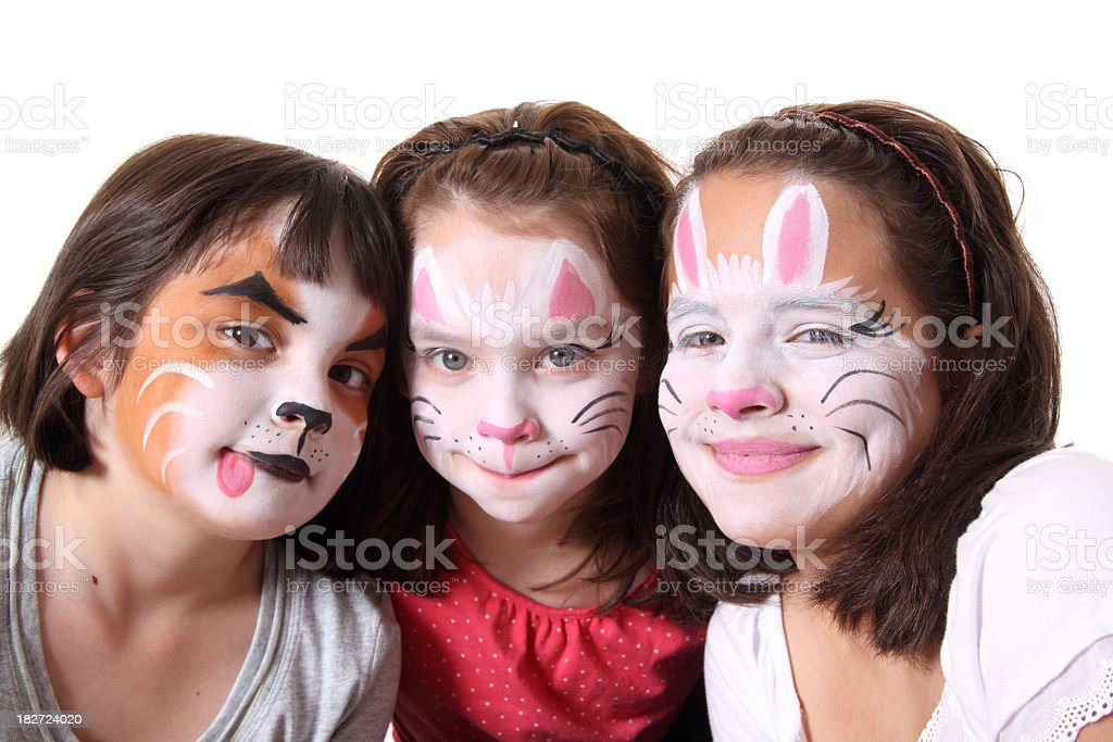 Three sisters with their faces painted stock photo