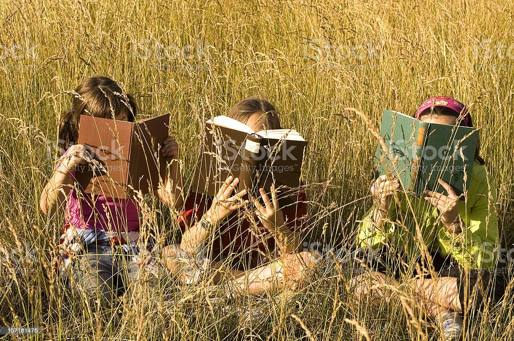 Three sitting and reading stock photo