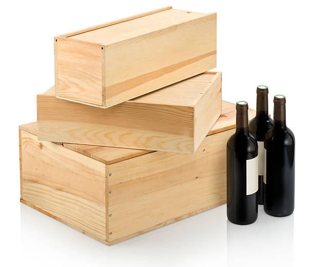 three sizes of wine boxes and accompanying wine - wine box bildbanksfoton och bilder