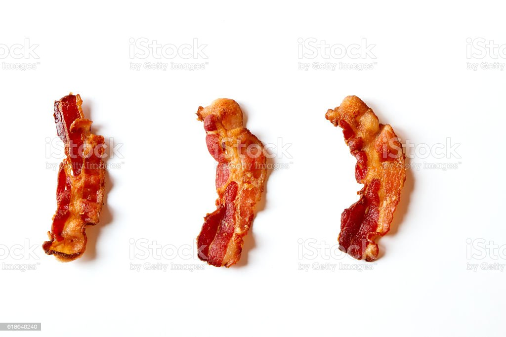 Three Slices of Bacon Isolated on a White Background stock photo