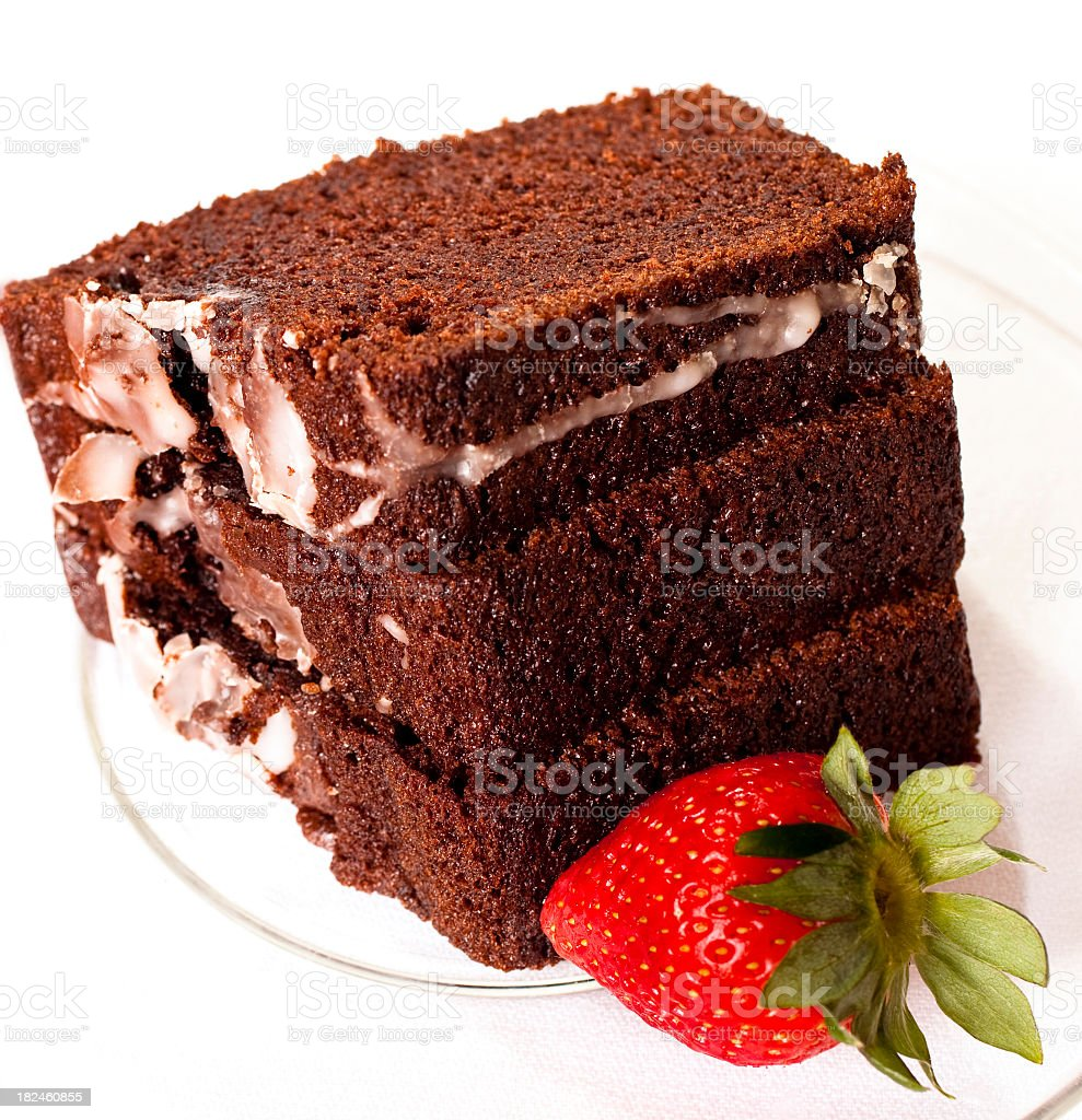 Three Slices of chocolate cake with icing and strawberry. royalty-free stock photo