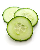 Three slices of cucumber on a white background