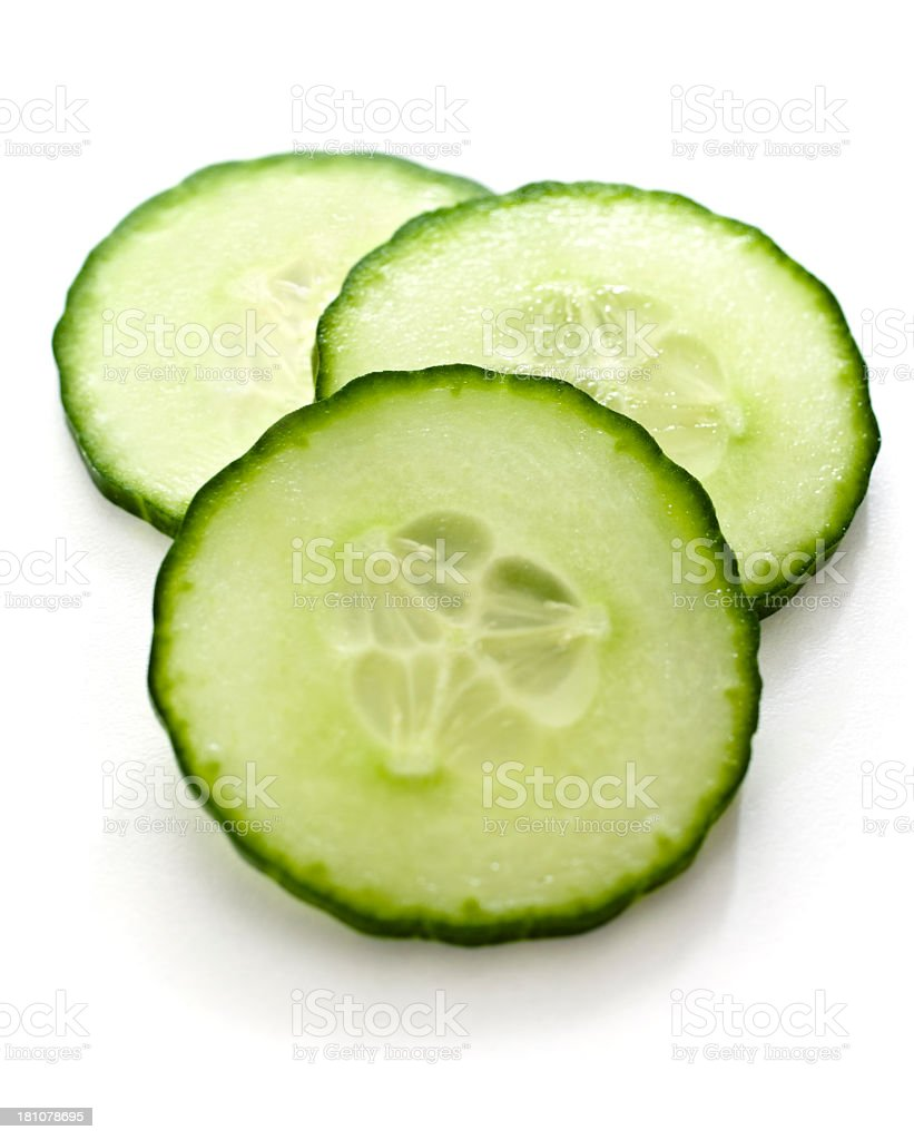 Three slices of cucumber on a white background stock photo