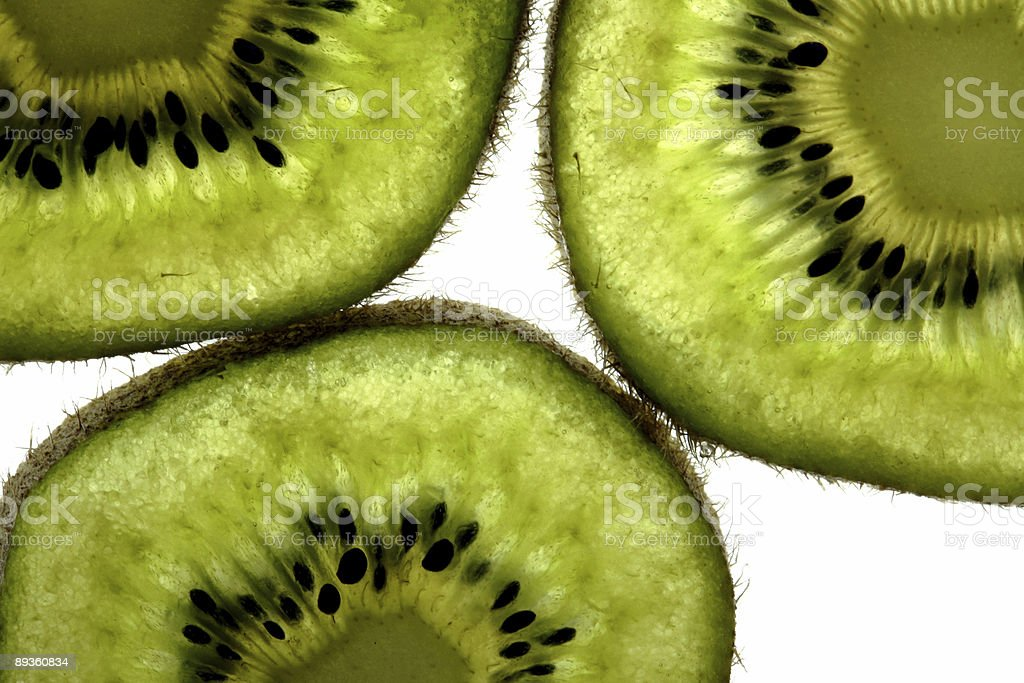 Three slices of kiwi royaltyfri bildbanksbilder