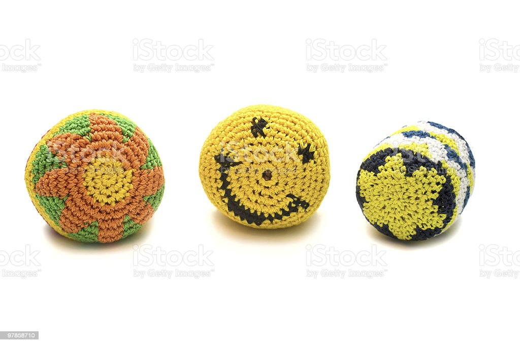 Three small colourful ball made of knitted wool. royalty-free stock photo
