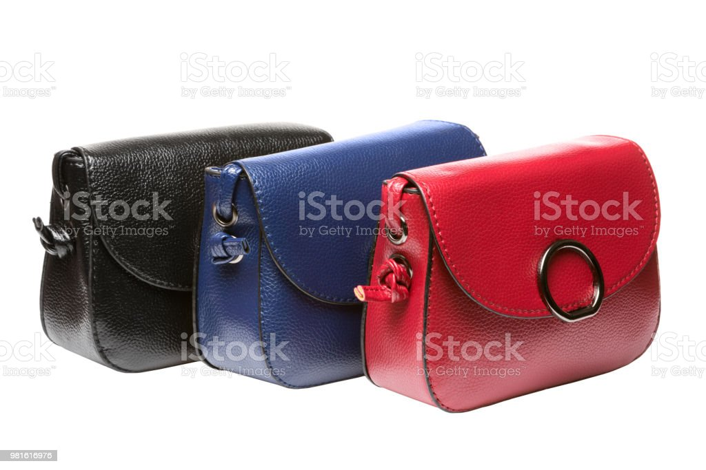 a7aaa9a4 three small female clutch bags, black, blue and red bags on a white  background