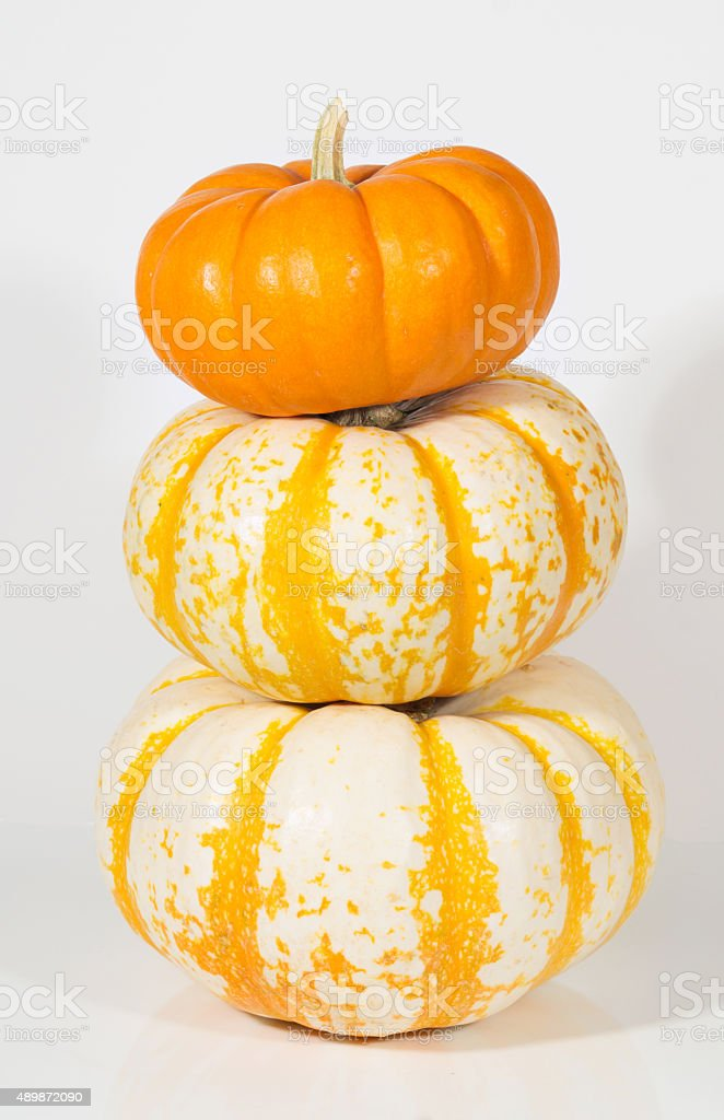 three small pumpkins stacked royalty-free stock photo