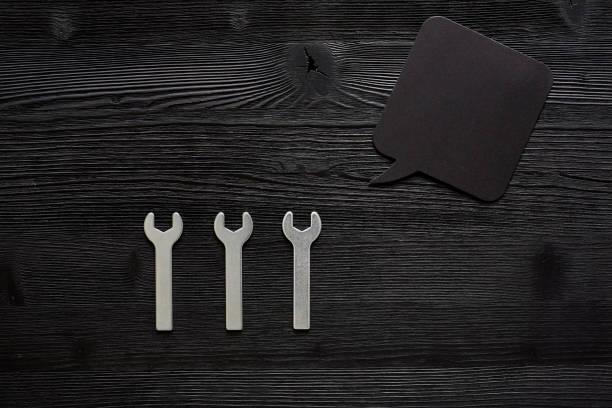 three small wrenches with speechbubble stock photo