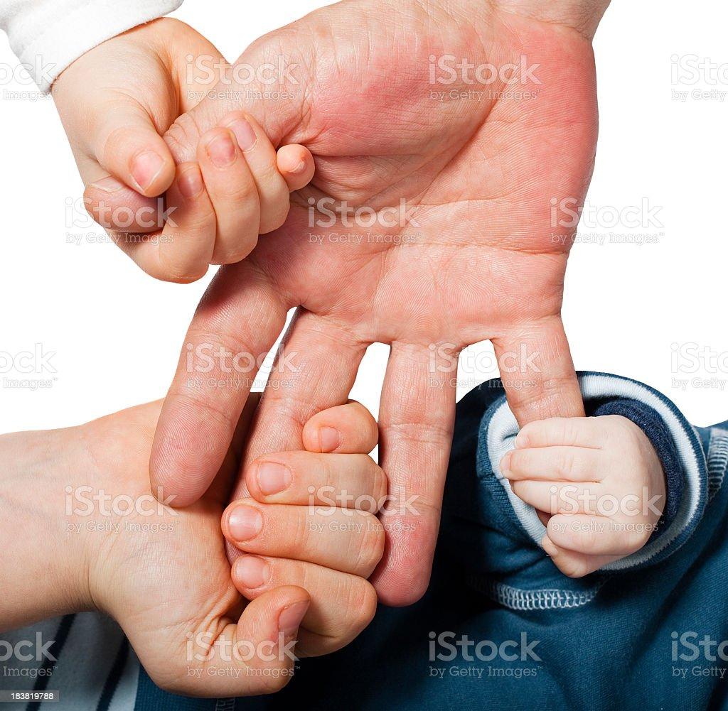 Three smaller hands grabbing onto one bigger hand royalty-free stock photo