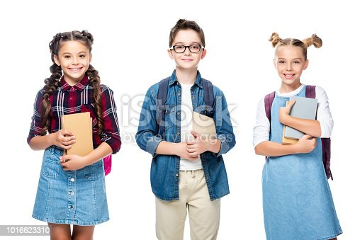 1016623732istockphoto three smiling classmates holding books and looking at camera isolated on white 1016623310