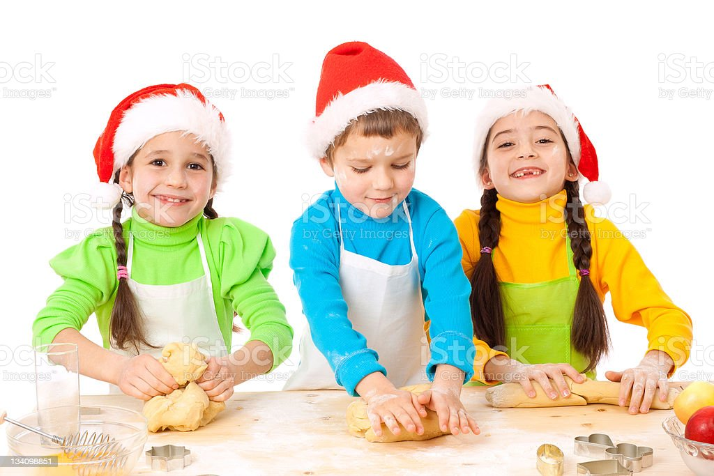 Three smiling kids with Christmas cooking royalty-free stock photo
