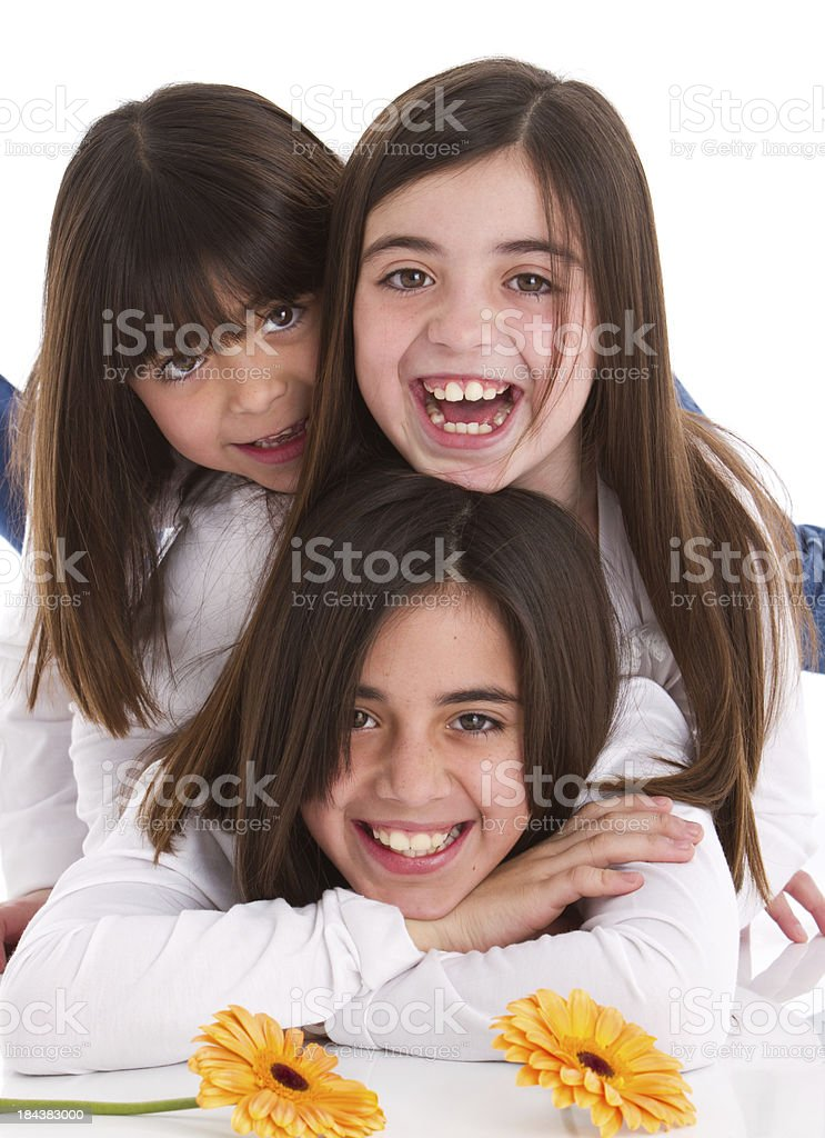 Three smiling latin american sisters with flowers royalty-free stock photo