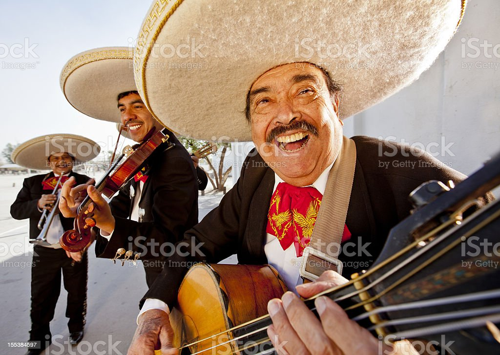 Three smiling members of a mariachi band stock photo