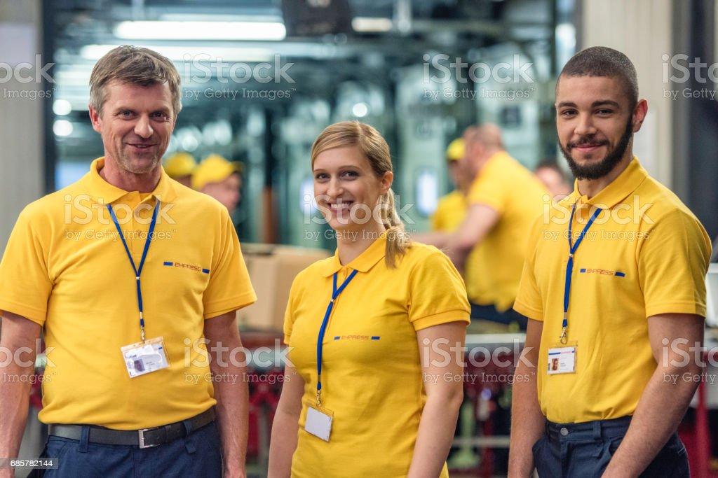 Three smiling postal workers looking at camera royalty-free stock photo