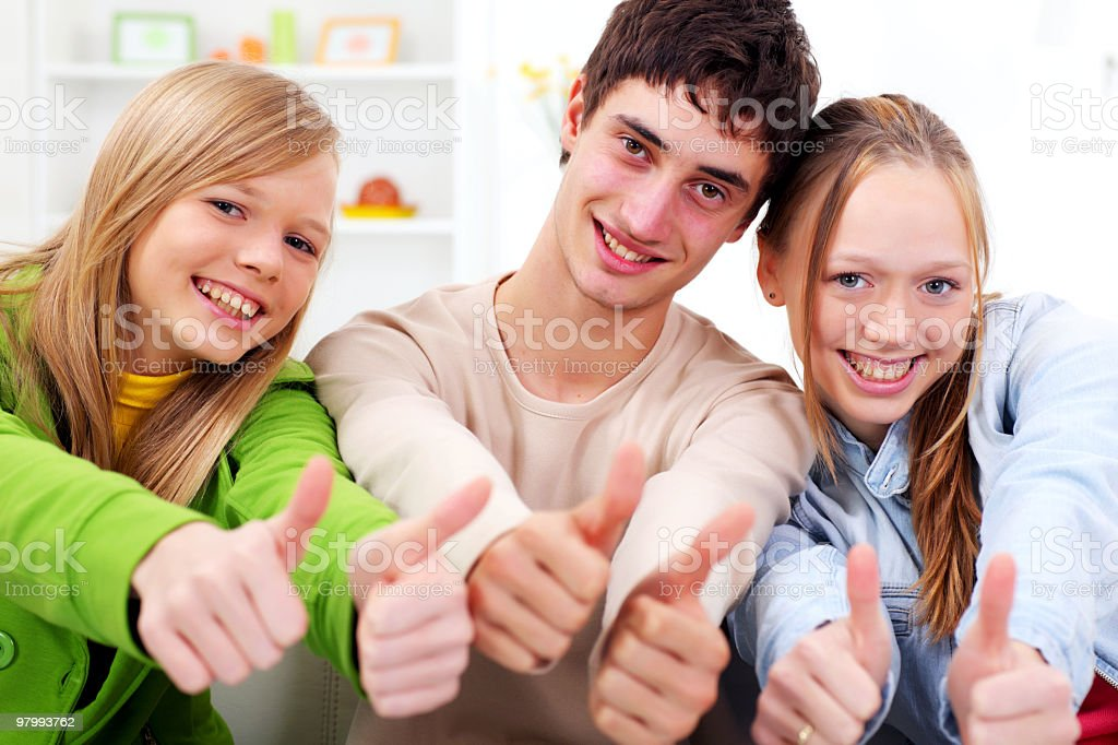 Three smiling teens showing ok witn fingers royalty free stockfoto