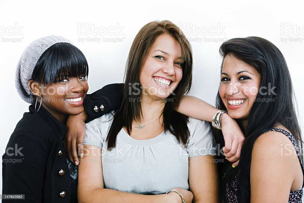 Three smiling young female friends stock photo