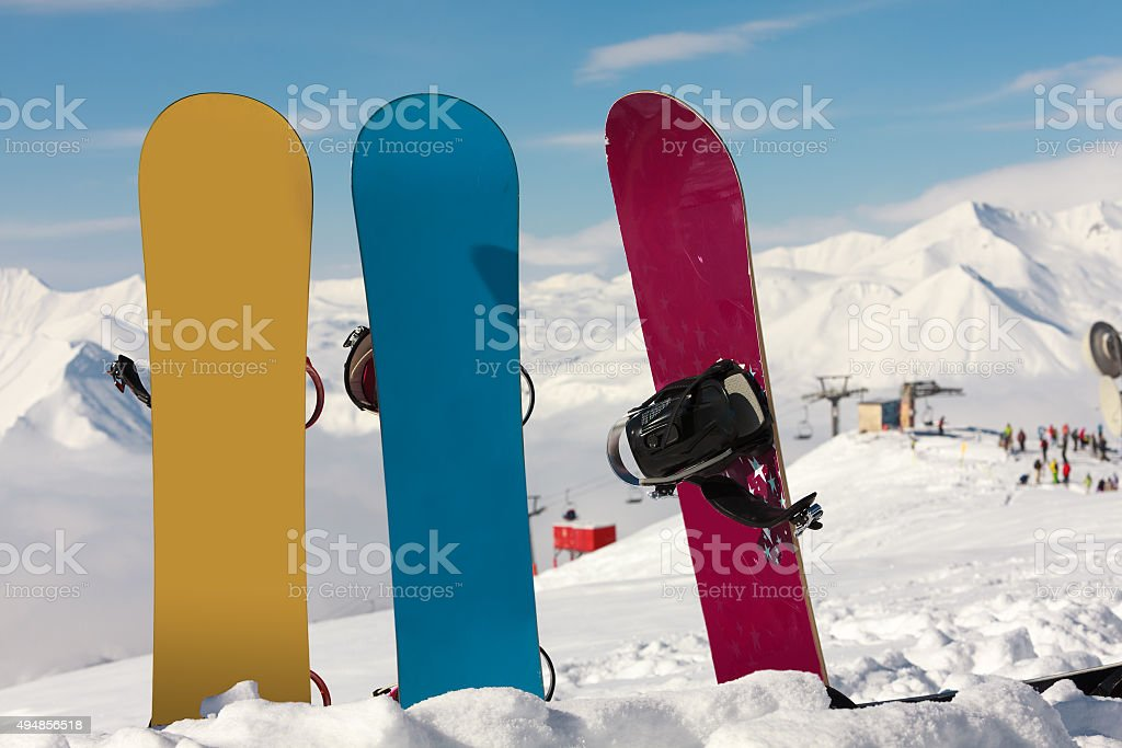 Three snowboards in snow at ski resort Gudauri, Georgia stock photo