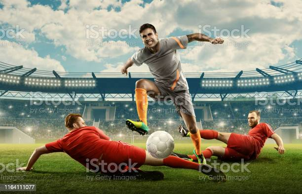Three soccer players fight for a ball on a stadium picture id1164111077?b=1&k=6&m=1164111077&s=612x612&h=7a uoi7i320dieif3w2xkuri0shu9w2vqm0ogv7cq40=