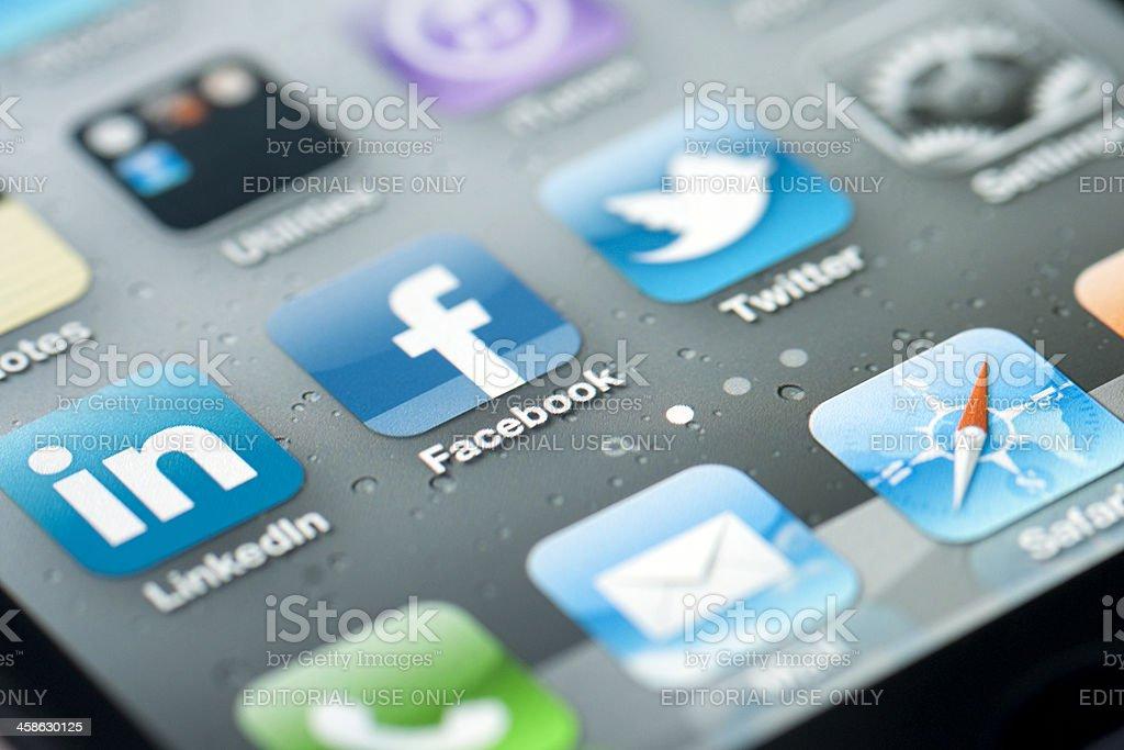 Three social media icons on iPhone screen royalty-free stock photo