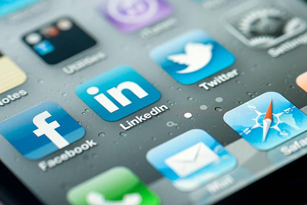 three social media icons on iphone screen - linkedin bildbanksfoton och bilder