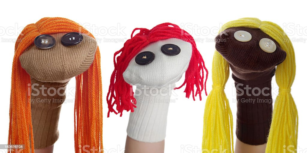 Three Sock Puppets in a Row on a White Background stock photo