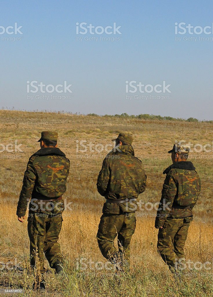 Three soldier in steppe stock photo
