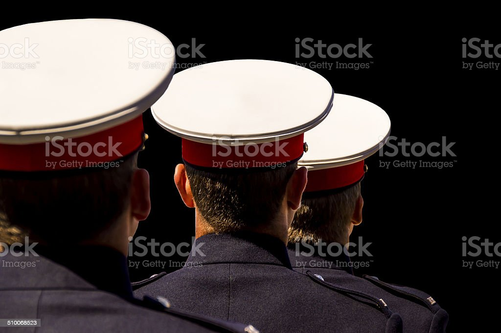 three soldiers isolated on a black background stock photo
