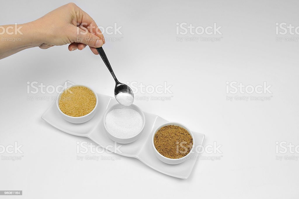 Three Sorts of Sugar Hand with Spoon royalty-free stock photo