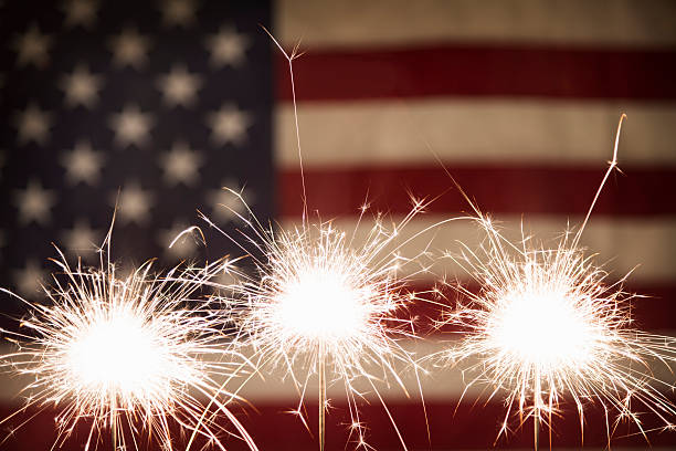 Three Sparklers with American Flag stock photo
