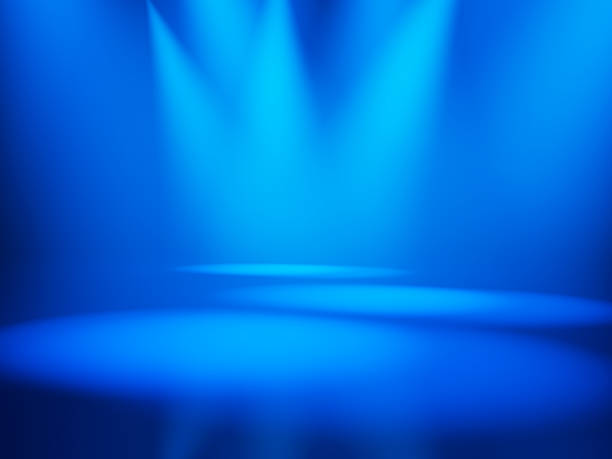 three spotlights illuminate and empty blue stage stock photo more
