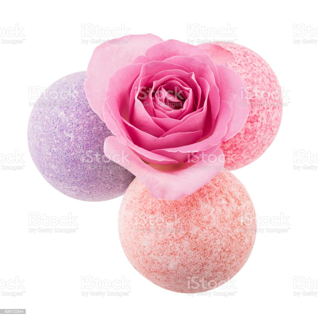 Three spotted bath bombs with pink rose stock photo