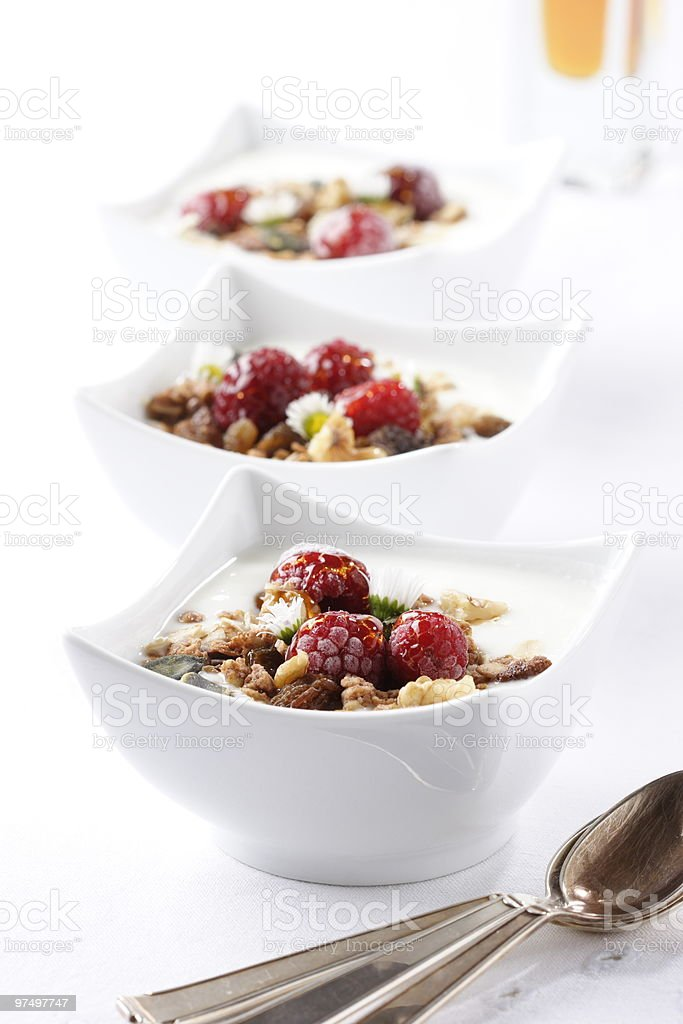 Three square bowls of muesli cereal with milk royalty-free stock photo