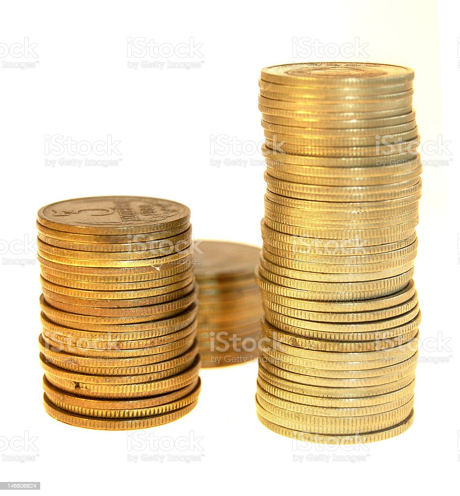 Three stacks of coins stock photo