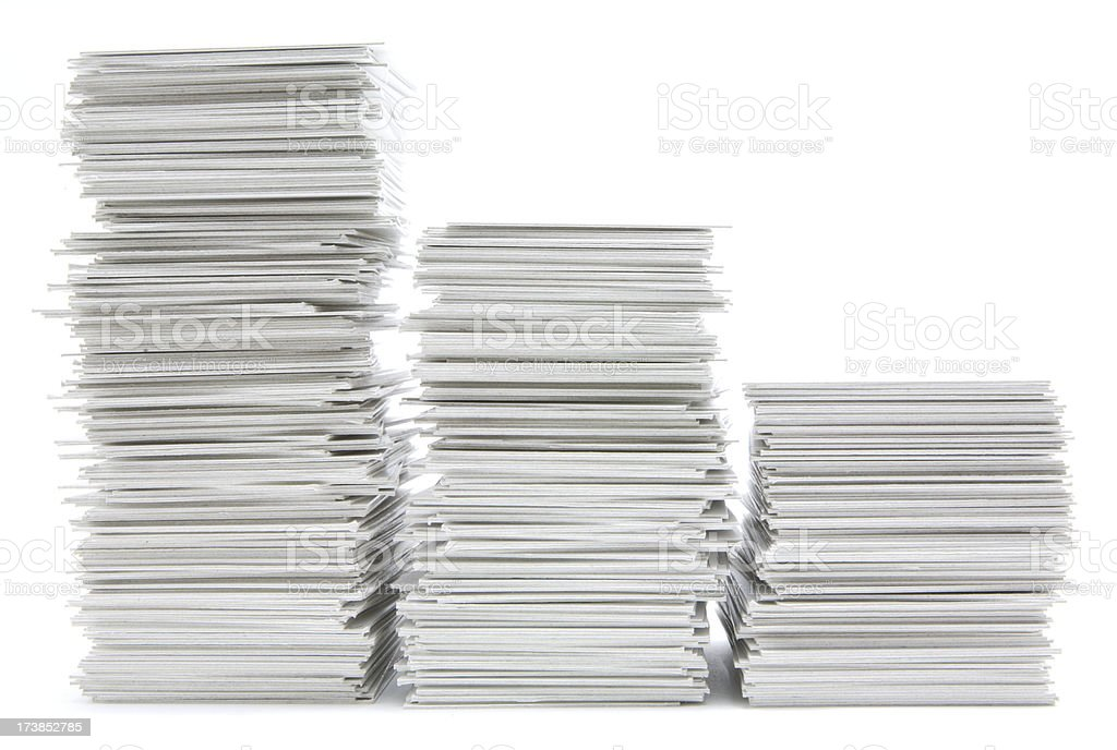 Three stacks of hand trimmed cards stock photo