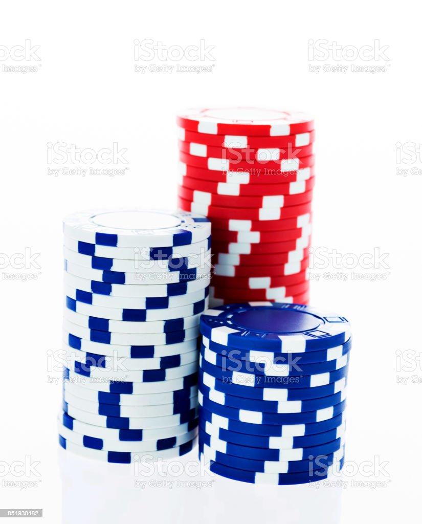 Three stacks of poker chips on white background stock photo