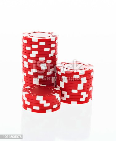 Three stacks of red poker chips on white background.