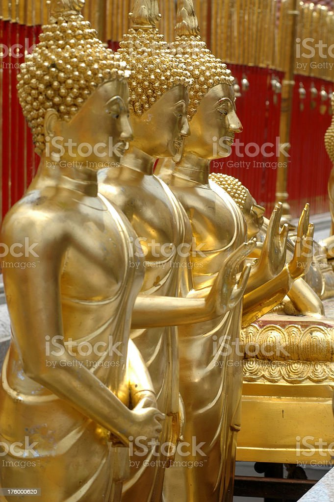 Three standing Buddha statues royalty-free stock photo