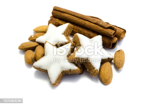 istock Three Star cookie wih almond and cinnamon isolated on white Background 1025363280