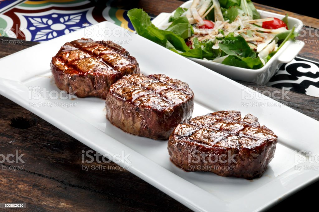 Three steaks roasted on the grill stock photo