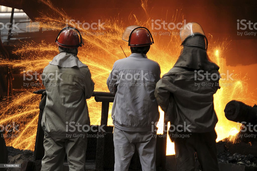 Three steel and iron workers is working royalty-free stock photo