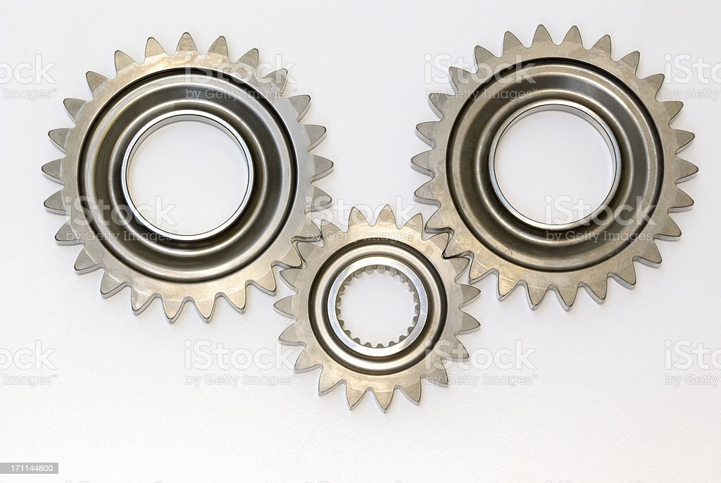 Three steel automobile gears isolated stock photo