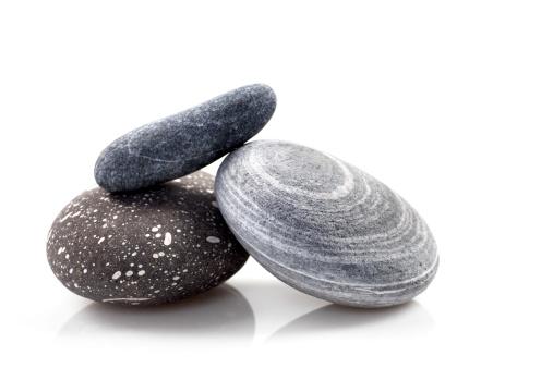 Three zen stones on white background